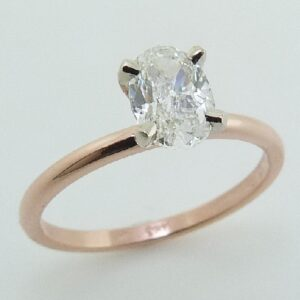 14 karat white and rose solitaire engagement ring featuring a 0.75ct H, VVS1 oval cut diamond.