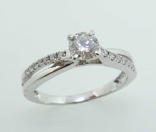 14 karat white solitaire engagement ring featuring a 0.428ct H, I1 round brilliant cut diamond and accented by 0.125ctw of round brilliant cut diamonds.
