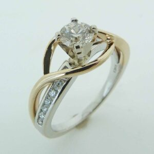 14 karat yellow and white solitaire engagement ring featuring a 0.55ct excellent cut good cut J/K, SI2/I1 round brilliant cut diamond accented by 14 = 0.20ctw H/I, SI2 round brilliant cut diamonds.