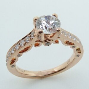 14 karat rose vintage design solitaire engagement ring featuring 0.46ctw G/H, SI1-2 round brilliant cut diamonds.