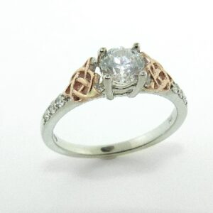 14 karat white and rose celtic design engagement ring accented by 6 = 0.13ctw G/H, SI1 round brilliant cut diamonds.