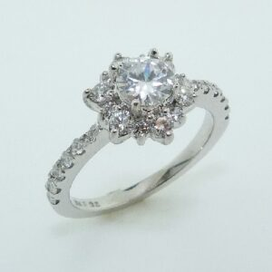 14 karat white floral design halo engagement ring accented by 0.275ctw round brilliant cut diamonds.