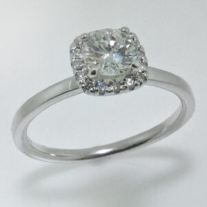 14 karat cushion halo engagement ring featuring a 0.51ctw, E, VS1, very good cut round brilliant cut diamonds and accented by a halo containing 16 = 0.139ctw.