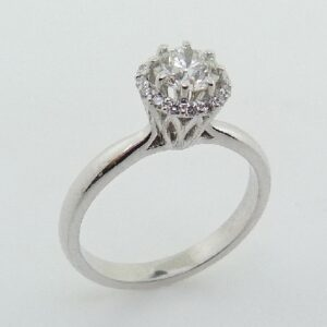 14 karat halo engagement ring featuring a 0.51ctw, G/H, I1 round brilliant cut diamond and accented by 16 = 0.10ctw round brilliant cut diamonds.