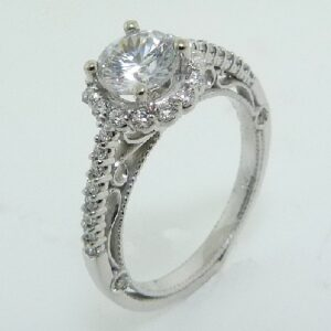 14 karat white engagement ring featuring 36 = 0.37ctw round brilliant cut diamonds that go halfway down the band.