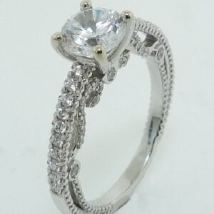 14 karat vintage engagement ring featuring 61 = 0.40ctw round brilliant cut diamonds.
