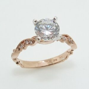 14 karat white and rose vintage solitaire design engagement ring accented by 22 = 0.12ctw round brilliant cut diamonds.