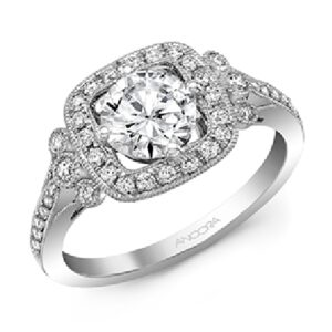 14 karat vintage halo engagement ring featuring 38 = 0.33ctw round brilliant cut diamonds