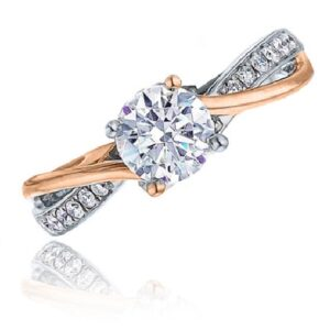 14K White and rose gold twisted band engagement ring by Frederic Sage claw set with a 0.50ct round CZ and accented on the pave set band with 14 round brilliant cut diamonds, 0.11 cttw. Available in 14K gold, 18K gold, or platinum. This ring can be made in any combination of white, pink or yellow gold and can be customized to accommodate different size and shape diamonds, by special order. Priced without a center gemstone. Let us find you the perfect center that fits your tastes and budget!