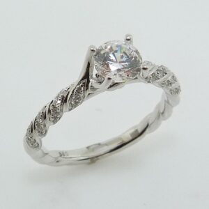 14K White gold Frederic Sage engagement ring with 0.50ct round CZ claw set centre and a rope twist band accented with 36 bead set round brilliant cut diamonds, 0.15cttw, G/H, VS-SI. Available in 14K gold, 18K gold, or platinum. This ring can be made in any combination of white, pink or yellow gold and can be customized to accommodate different size and shape diamonds, by special order. Priced without a center gemstone. Let us find you the perfect center that fits your tastes and budget!