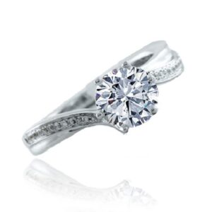 14K White gold Frederic Sage engagement ring with 0.75ct round CZ set into a six prong centre and accented on the band with 22 round brilliant cut diamonds, 0.08cttw, G/H, VS-SI. Available in 14K gold, 18K gold, or platinum. This ring can be made in any combination of white, pink or yellow gold and can be customized to accommodate different size and shape diamonds, by special order. Priced without a center gemstone. Let us find you the perfect center that fits your tastes and budget!