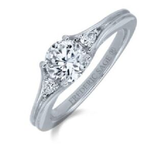 14K White gold three stone engagement ring by Frederic Sage set with a 1ct CZ center and accented on the sides with 2 pear shape diamonds, 0.12cttw. Available in 14K gold, 18K gold, or platinum. This ring can be made in any combination of white, pink or yellow gold and can be customized to accommodate different size and shape diamonds, by special order. Priced without a center gemstone. Let us find you the perfect center that fits your tastes and budget!