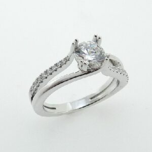 14K White gold split shank engagement ring by Frederic Sage featuring split prongs on the centre 0.75ct CZ. The split shank band has 20 mircoset diamonds totaling 0.13 carats graduating in size towards the centre and an opposite polished shank. Available in 14K gold, 18K gold, or platinum. This ring can be made in any combination of white, pink or yellow gold and can be customized to accommodate different size and shape diamonds, by special order. Priced without a center gemstone. Let us find you the perfect center that fits your tastes and budget!
