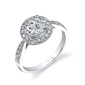 Modern halo design engagement ring by Sylvie Collection featuring 0.32ctw G/H, VS-SI round brilliant cut diamonds.