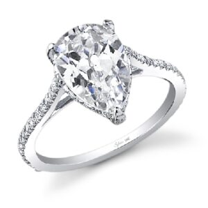 Madalyn pear shaped solitaire engagement ring by Sylvie Collection featuring 0.31ctw G/H, VS-SI round brilliant cut diamonds which go halfway down the band