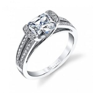 This engagement ring by Sylvie Collection is a unique split shank design featuring 0.22ctw G/H, VS-SI round brilliant cut diamonds.