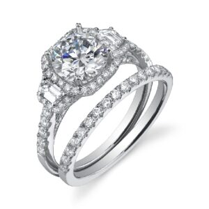 Paris three stone engagement ring by Sylvie Collection featuring 2 = 0.24ctw G/H, VS-SI trapezoid cut diamond and 0.68ctw G/H, VS-SI round brilliant cut diamonds which go halfway down the band