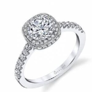 Alix classic halo engagement ring by Sylvie Collection featuring 0.44ctw G/H, VS-SI round brilliant cut diamonds which go halfway down the band