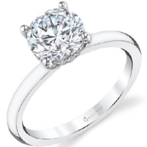 Solitaire engagement ring by Sylvie Collection featuring a hidden halo 0.12ctw G/H, VS-SI round brilliant cut diamonds.