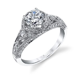 Shayna vintage inspired halo engagement ring by Sylvie Collection featuring 0.64ctw G/H, VS-SI round brilliant cut diamonds.