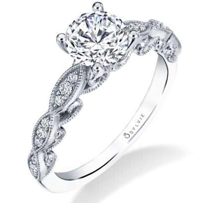 Florine vintage solitaire engagement ring by Sylvie Collection featuring 0.11ctw G/H, VS-SI round brilliant cut diamonds which go halfway down the band