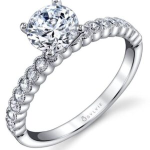 Albertine modern solitaire engagement ring by Sylvie Collection featuring 0.30ctw G/H, VS-SI round brilliant cut diamonds which go halfway down the band.