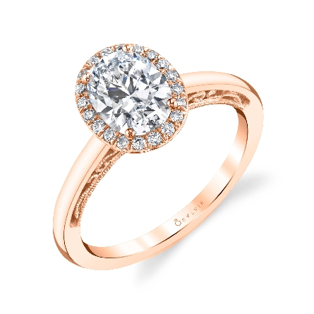 Oval halo engagement ring by Sylvie Collection featuring 0.19ctw G/H, VS-SI round brilliant cut diamonds. This ring has beautiful filigree and milgrain detail under the head as well as stunning diamond accents.