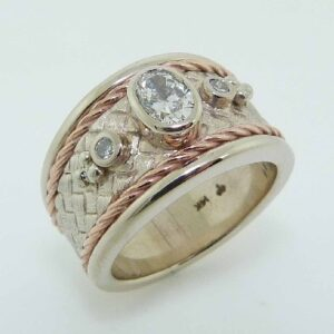 lady's 14K White/Rose gold bezel set diamonds ring