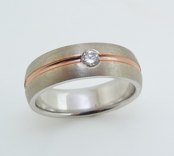 14K White and rose gold men's two tone band accented with a gypsy set 0.15 carat round brilliant cut diamond, SI1.