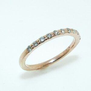 14 karat rose gold band set with 11 = 0.13ctw excellent cut, F/G, SI1 round brilliant cut diamonds.