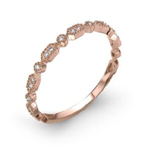14 karat rose gold band set with 0.08ctw round brilliant cut diamonds. This stunning ring features milgrain engraving and is beautiful by itself or as part of a stack.