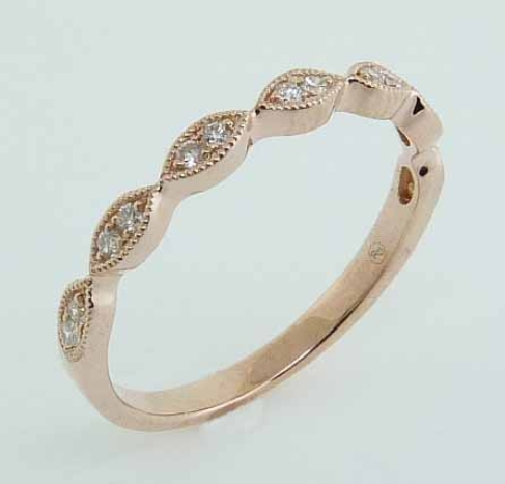 14 karat rose gold band set with 14 = 0.11ctw G/H/I, SI round brilliant cut diamonds. This stunning ring features milgrain engraving and is beautiful by itself or as part of a stack.