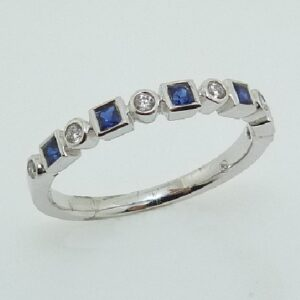 14 karat white gold band set with 6 = 0.07ctw round brilliant cut diamonds and 5 = 0.27ctw sapphires.