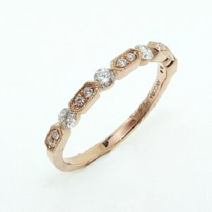 14 karat rose gold band set with 14 = 0.31ctw G/H, SI round brilliant cut diamonds. This stunning ring features milgrain engraving and is beautiful by itself or as part of a stack.