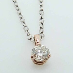 14k rose gold 3 prong pendant set with a 0.38ct I/J, VS2, round brilliant cut diamond.