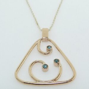 14k rose gold modern design pendant featuring treated blue diamonds