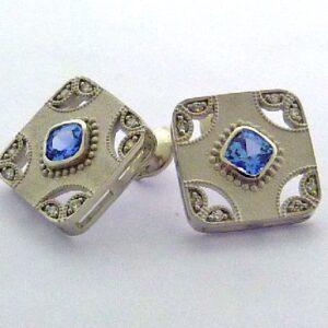 14k stud earrings featuring 0.969ctw of sapphires and 0.148ctw of round brilliant cut diamonds. This is a custom design by Studio Tzela.