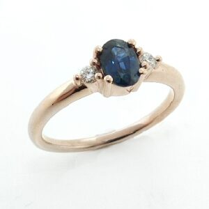 14 karat rose gold ring featuring a 0.543ct oval sapphire and 2 = 0.07ct, excellent cut, F/G, SI round brilliant cut diamonds.