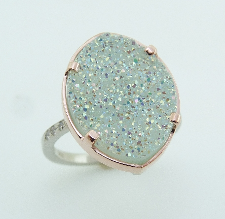 14 karat rose and white gold ring featuring coated agate druzy and accented with 6 = 0.045ctw round brilliant cut diamonds. This stunning ring is a custom Design by David.