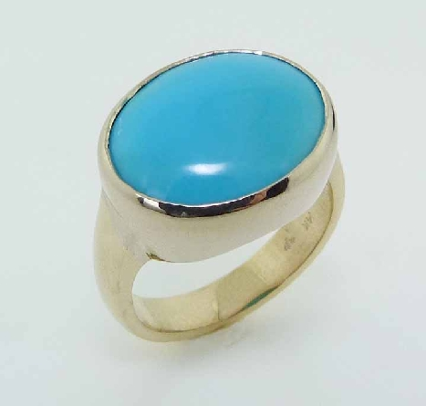 14 karat yellow gold ring featuring a 5.93ctw Turquoise. This stunning ring is a custom Design by David.