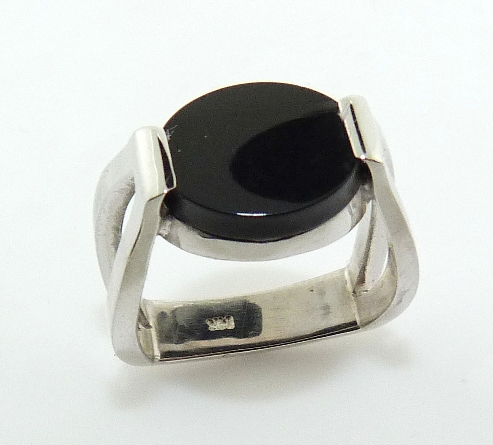 14 karat white gold ring featuring an onyx. This stunning ring is a custom Design by David.