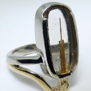 14 karat yellow and white gold ring featuring rutilated quartz. This stunning ring is a custom design by David.