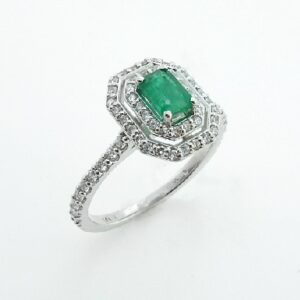 14 karat white gold double halo ring set with a 0.442ct Emerald accented by 62 = 0.37ctw round brilliant cut diamonds.
