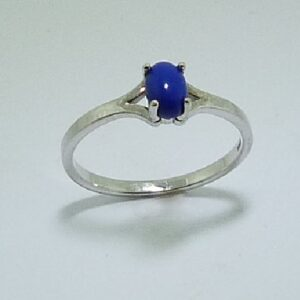 14 karat white gold ring featuring a cabochon cut lapiz lazuli. This stunning ring is a custom Design by David.