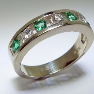 14 karat white gold ring channel set with 4 = 0.21ctw emeralds and 3 = 0.199ctw, G/H, VS-SI, round brilliant cut diamonds