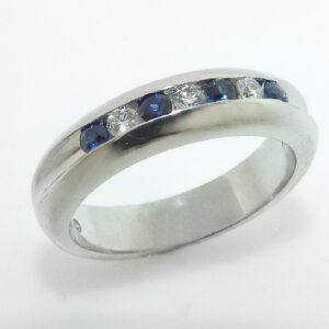 14 karat white gold wedding band set with ideal cut, round brilliant cut diamonds by Hearts On Fire, 0.109 carat total weight, VS2-SI1, G/H and 0.20ctw blue sapphires.