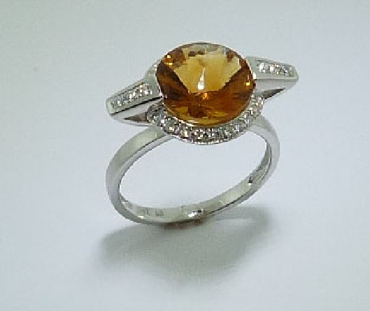 14 karat white gold ring set with a 3.14ct citrine and accented with 28 = 0.184ctw round brilliant cut diamonds.