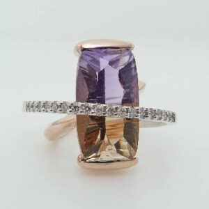 14K white & rose gold custom Studio Tzela ring showcasing a semi bezel set concave, antique cushion cut ametrine, 8.98ct and an arcing band of 18 claw set round brilliant cut diamonds totaling 0.20cttw, H/I, SI2.