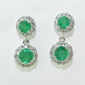 14 karat white gold halo earrings set with 4 = 0.45ctw emeralds and 40 = 0.18ctw, G/H, SI, round brilliant cut diamonds.