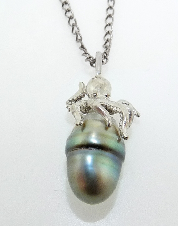 14 karat white gold unique pendant in the style of an octopus holding an acorn pearl
